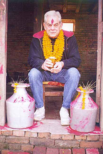 Uncle Bill relaxes at the door of BirGorkha with beer and cigarette