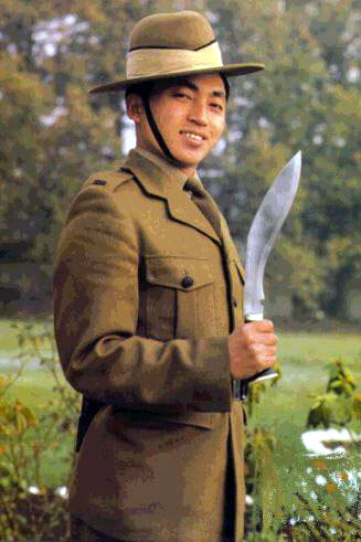 a young Gurkha presents arms