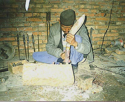 Kesar making a khukuri handle